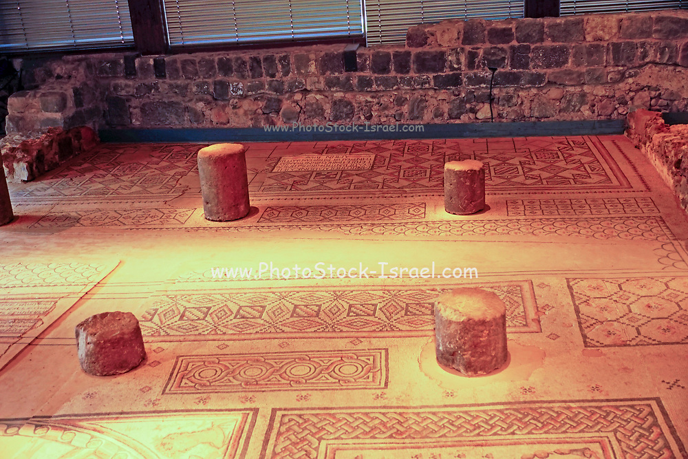 Zodiac mosaic floor, synagogue in Hamat Tiberias Hamat Tverya National Park is an ancient archaeological site and an Israeli national park, On the shore of the Sea of Galilee, Tiberias, Israel. The mosaic floor is made up of three panels featuring: inscriptions and dedications; the zodiac panel, including Helios the sun god and four women symbolizing the four seasons of nature; while the upper panel depicts the Temple of Jerusalem plus the primary symbols of Judaism, the menorah candelabra, shofar horn, arbaa-minim plants, and a mahta shovel.