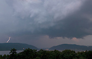 Newburgh, New York - Lightning  strikes in the distance on the east side of the Hudson River in a view looking south from Bay View Terrace on July 4, 2012.