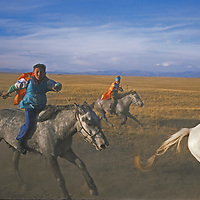Youngsters ride their horses bareback and barefoot to save weight at a traditional Naadam race in the Darhad Valley in northern Mongolia.
