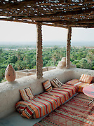 The terrace of a small hotel in Dadès, overlooking the palms of the Skoura Oasis in Morocco