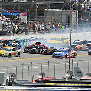 NASCAR Sprint Cup driver Tony Stewart (14)  and NASCAR Sprint Cup driver Ricky Stenhouse Jr. (17)  are involved in a crash on the front stretch during the 56th Annual NASCAR Coke Zero 400 race at Daytona International Speedway on Sunday, July 6, 2014 in Daytona Beach, Florida.  (AP Photo/Alex Menendez)