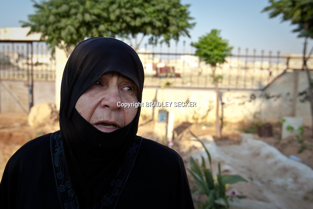A mother grieves over the grave of her son, who was killed when the Syrian army raided the town of Sarmin, in Idlib province. Idlib province in Syria's northwest is one of the few areas in Syria which is currently under FSA control, although this control is patchy and ever shifting. Sarmin, Idlib, Syria. 18/06/2012