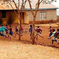 Africa, Tanzania, Karatu. Tloma Primary School Children running for lunch break n Karatu, Tanzania.