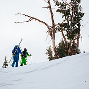 Jess McMillan and Tanner Flanagan hike towards the backcountry near Jackson Hole Mountain Resort.
