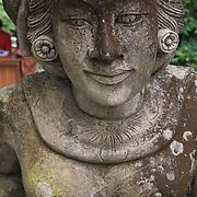 Buddhist statues at Goa Gajah sanctuary in the village of Bedulu. Indonesia.
