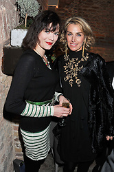 Left to right, JASMINE GUINNESS and ASSIA WEBSTER at an evening of cheesey culinary delights & champagne hosted by Alex James, Yasmin Mills and Elaine Foran held at Aubaine, 31 Dover Street, London on 20th March 2012.