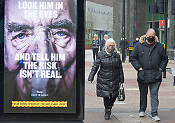 © Licensed to London News Pictures 06/02/2021.        Bromley, UK. Government Coronavirus Advertising. Shoppers out and about on Bromley High Street in South East London today as more areas in England get door to door covid tests for the South African variant of Covid-19. Photo credit:Grant Falvey/LNP