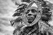 A portrait in black and white of a Maasai chief wearing his traditional head dress ,Amboseli, Kenya, Africa