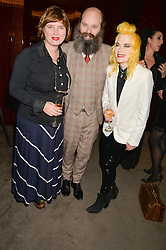 Left to right, DEBORAH CURTIS, GAVIN TURK and PAM HOGG at a dinner hosted by Liberatum to honour Francis Ford Coppola held at the Bulgari Hotel & Residences, 171 Knightsbridge, London on 17th November 2014.
