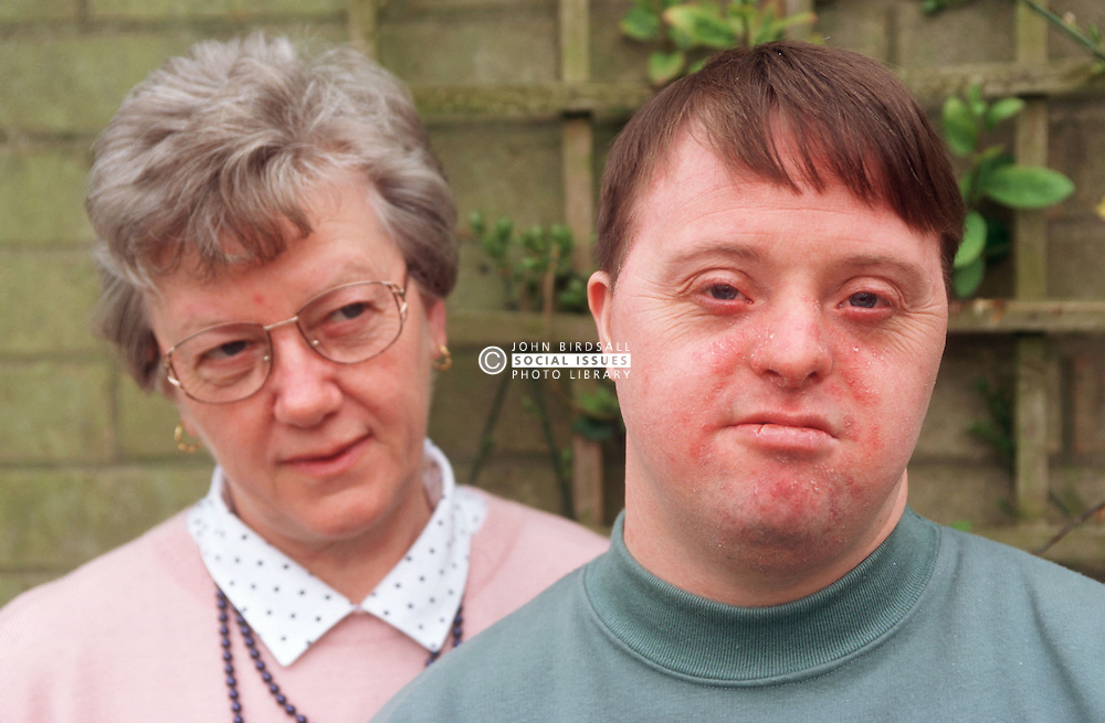 Portrait of mother and adult son with Downs Syndrome,