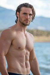 sexy shirtless muscular man at a lake