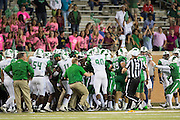 A skirmish breaks out on the field between the Marshall Thundering Herd and the North Texas Mean Green during the 2nd half at Apogee Stadium in Denton, Texas on October 8, 2016. (Cooper Neill for The Herald-Dispatch)
