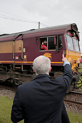 © Licenced to London News Pictures. 07/07/2017. Labour Party Leader Jeremy Corbyn signals to a passing train driver during his visit to the British Steel plant in Skinningrove on Teesside. Photo credit: Stuart Boulton/LNP