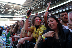 Fans during Capital's Summertime Ball. The world's biggest stars perform live for 80,000 Capital listeners at Wembley Stadium at the UK's biggest summer party. PRESS ASSOCIATION PHOTO. Picture date: Saturday June 8, 2019. Photo credit should read: Isabel Infantes/PA Wire