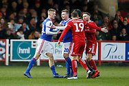 Ipswich Town midfielder Flynn Downes (21) has a disagreement with Accrington players  during the The FA Cup 3rd round match between Accrington Stanley and Ipswich Town at the Fraser Eagle Stadium, Accrington, England on 5 January 2019.