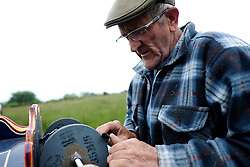 © Licensed to London News Pictures. <br /> 05/06/2014. <br /> <br /> Appleby, Cumbria, England<br /> <br /> Trevor Jones from the Wirral sharpens knives as gypsies and travellers gather during the annual horse fair on 5 June, 2014 in Appleby, Cumbria. The event remains one of the largest and oldest events in Europe and gives the opportunity for travelling communities to meet friends, celebrate their music, folklore and to buy and sell horses.<br /> <br /> The event has existed under the protection of a charter granted by King James II in 1685 and it remains the most important event in the gypsy and traveller calendar.<br /> <br /> Photo credit : Ian Forsyth/LNP