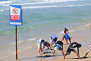Israel, Haifa, summer activity on the beach Surfers workout on the beach