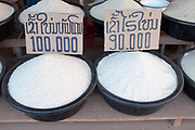 Rice for sale at Don Makai evening market in the outskirts of Vientiane, Lao PDR. A large variety of local products are available for sale in fresh markets all over Laos, all being sold on small individual stalls.