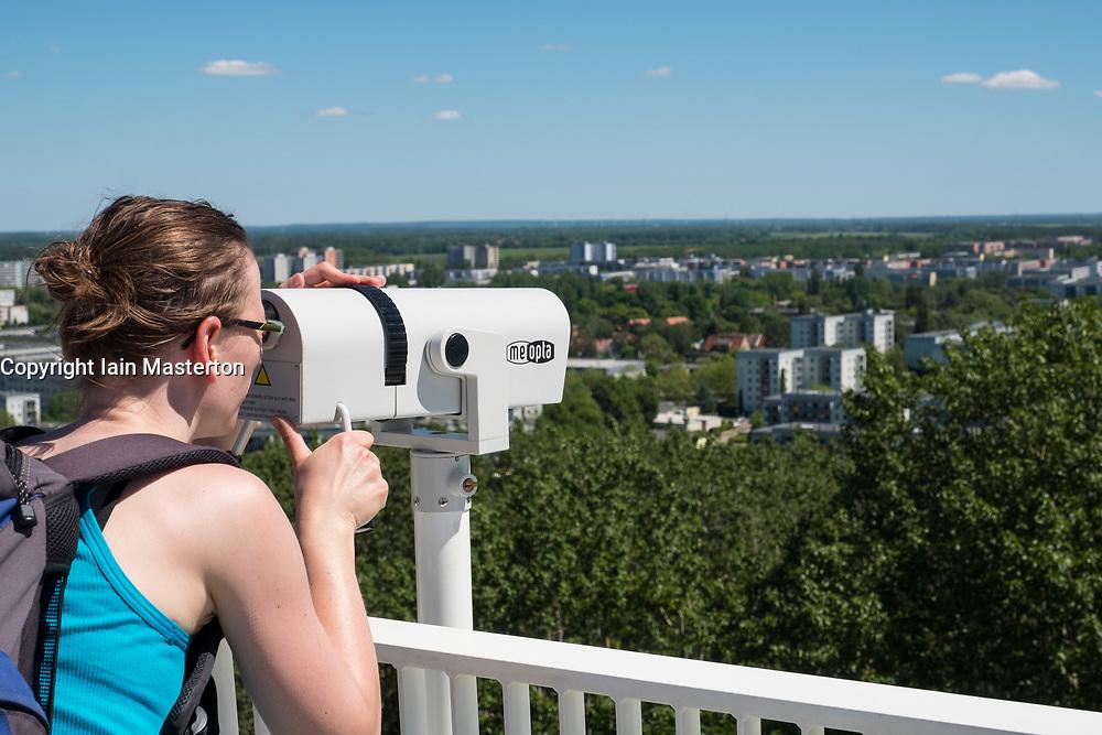 Visitor on viewing platform using telescope at IFA 2017 International Garden Festival (International Garten Ausstellung) in Berlin, Germany