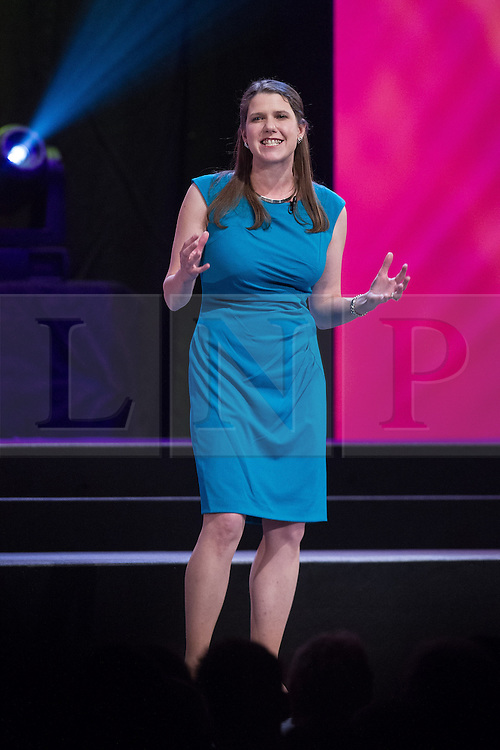 © Licensed to London News Pictures . 04/10/2014 . Glasgow , UK . JO SWINSON addresses a party rally at The Liberal Democrat Party Conference 2014 at the Scottish Exhibition and Conference Centre in Glasgow . Photo credit : Joel Goodman/LNP