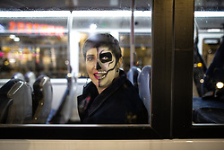 © Licensed to London News Pictures . 28/10/2018. Manchester, UK. A woman in fancy dress on a bus in Piccadilly Gardens . Revellers on a night out , many in fancy dress , on the weekend before Halloween . Photo credit: Joel Goodman/LNP