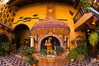 Beautiful artwork decorates the courtyard of  the colonial style Hotel El Fuerte, El Fuerte, Mexico