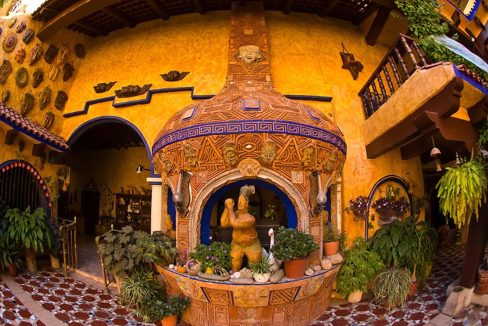 Beautiful artwork decorates the courtyard of  the colonial style Hotel El Fuerte, El Fuerte, Mexico