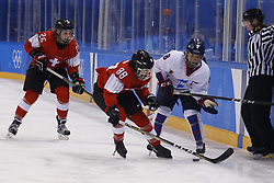 February 18, 2018 - Pyeongchang, KOREA - Switzerland forward Phoebe Staenz (88) and Korea defenseman Selin Kim (8) in a hockey game between Switzerland and Korea during the Pyeongchang 2018 Olympic Winter Games at Kwandong Hockey Centre. Switzerland beat Korea 2-0. (Credit Image: © David McIntyre via ZUMA Wire)