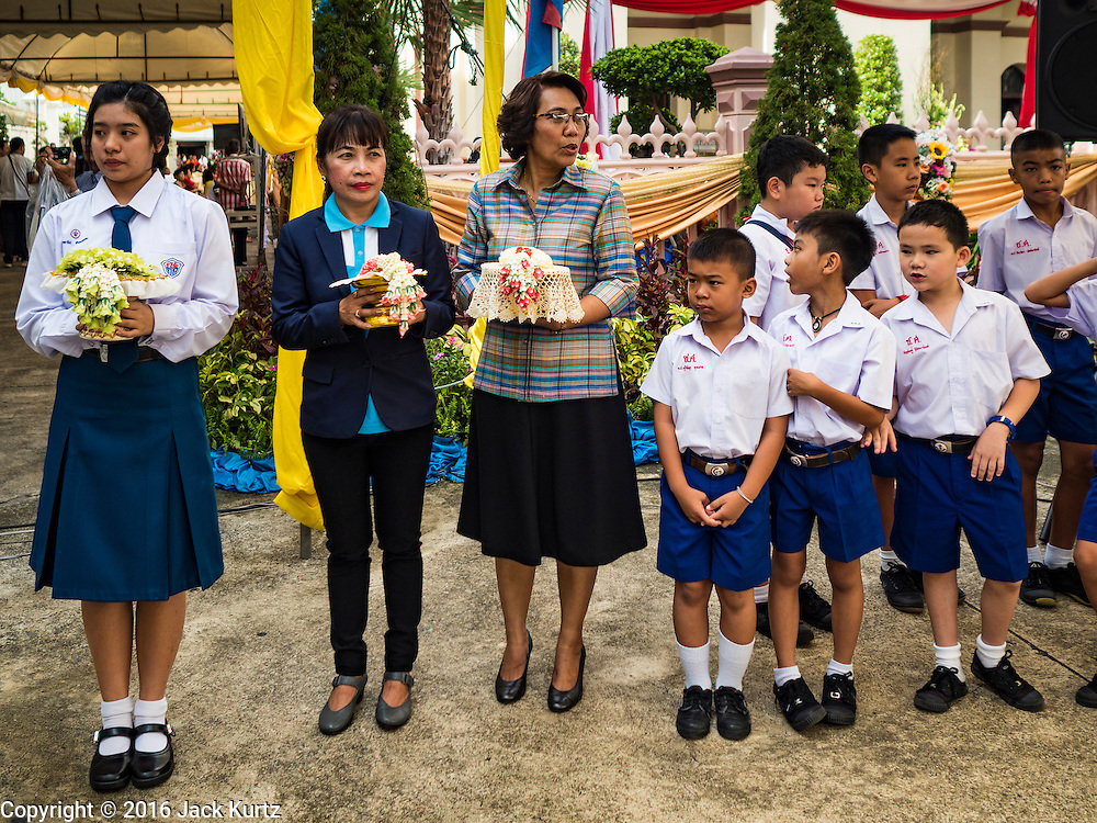 18 SEPTEMBER 2016 - BANGKOK, THAILAND: Students wait to greet the Archbishop of Bangkok at Santa Cruz before the church's 100th anniversary mass to start. Santa Cruz Church was establised in 1769 to serve Portuguese soldiers in the employ of King Taksin, who reestablished the Siamese (Thai) empire after the Burmese sacked the ancient Siamese capital of Ayutthaya. The church was one of the first Catholic churches in Bangkok and is one of the most historic Catholic churches in Thailand. The first sanctuary was a simple wood and thatch structure and burned down in the 1800s. The church is in its third sanctuary and was designed in a Renaissance / Neo-Classical style. It was consecrated in September, 1916. The church, located on the Chao Phraya River, serves as a landmark for central Bangkok.       PHOTO BY JACK KURTZ