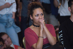 November 9, 2016 - A young Hillary Clinton supporter prays as results roll in, during an election night watch party, Austin Texas (Credit Image: © Sandy Carson via ZUMA Wire)