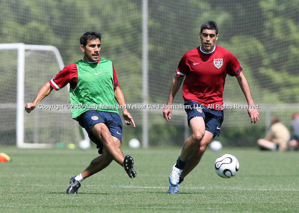 Pablo Mastroeni (l) plays the ball past Claudio Reyna (r) on Wednesday, May 17th, 2006 at SAS Soccer Park in Cary, North Carolina. The United States Men's National Soccer Team held a training session as part of their preparations for the upcoming 2006 FIFA World Cup Finals being held in Germany.