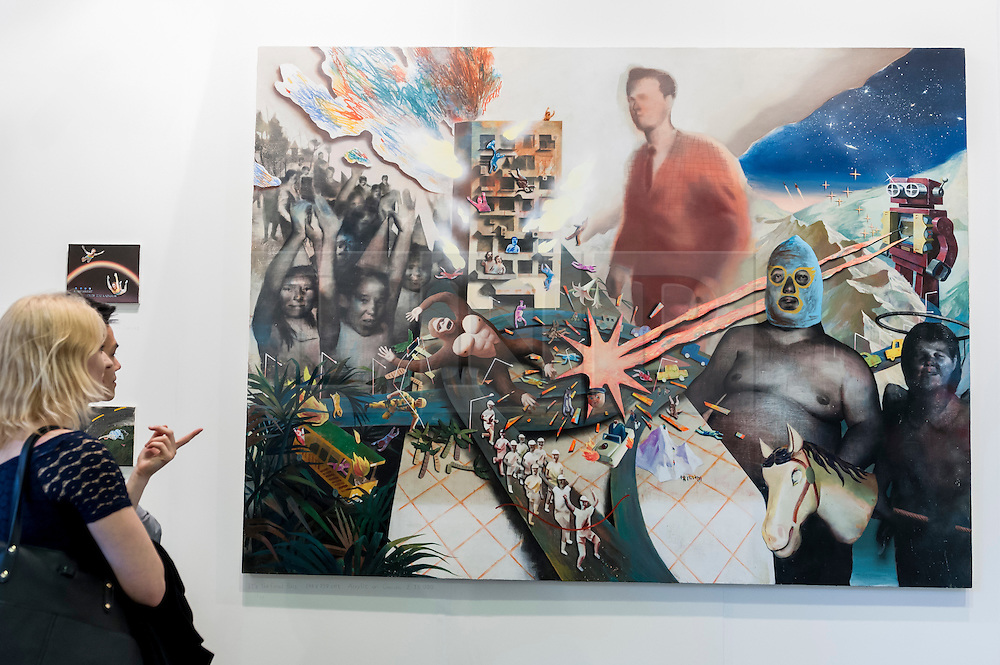 """© Licensed to London News Pictures. 19/05/2016. London, UK. Visitors look at Lai Wei-Yu's """"It's the Final Boss"""".  Art16 opens at Olympia, in west London.  Now in its fourth edition, the fair brings together over 100 galleries from more than 30 countries showcasing a diverse cross-section of work by contemporary artists from around the world for buyers and art enthusiasts to visit. Photo credit : Stephen Chung/LNP"""