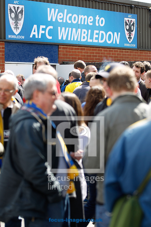 Picture by Andrew Tobin/Focus Images Ltd +44 7710 761829.27/04/2013. AFC Wimbledon fans before the npower League 2 match at the Cherry Red Records Stadium, Kingston.