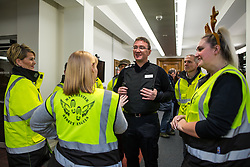 """© Licensed to London News Pictures . 18/12/2015 . Manchester , UK . Newly appointed Chief Constable IAN HOPKINS speaks to volunteer """" Street Angels """" at a police briefing ahead of the evening . Revellers in Manchester enjoy """" Mad Friday """" - also known as """" Black Eye Friday """" - the day on which emergency services in Britain are typically at their busiest , as people head out for parties and drinks to celebrate Christmas . Photo credit : Joel Goodman/LNP"""