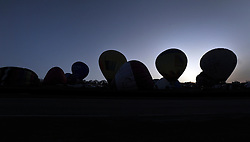 ©London News pictures. 07/04/2011. CANTERBURY: Balloons wait for the dawn take off slot. Approximately 50 hot air balloons from across the UK and Europe take advantage of the weather window and take off from Lydden Hill Race Circuit, Wootton, Kent, to fly across the English Channel marking the largest ever group of balloons to attempt the crossing. The participants  have been waiting since October for the event to happen. Picture credit should read Stephen Simpson/LNP