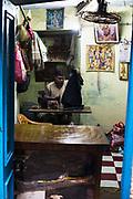 A Tailor working at his tailorshop in Varanasi, India