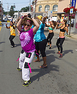 Middletown, New York - People take part in Zumba in the Street during the Orange Regional Medical Center's Run 4 Downtown road race on Aug. 16, 2014. All the proceeds from the Run 4 Downtown go to revitalizing Middletown's Historic district.