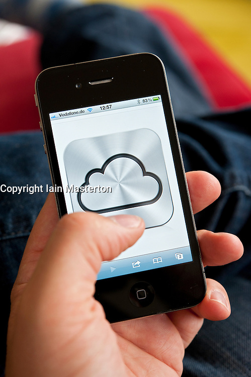 iCloud cloud computing service icon on an iPhone 4G smart phone screen