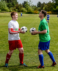 Pictured: Ryan (left) and Daniel (right) go head to head as team captains before the match.<br /> <br /> Brothers Ryan and Daniel Flannigan from Armadale, West Lothian organised a charity football match and fun day in aid of Macmillan Cancer Support after Ryan's partners father Terry McMillan was diagnosed with terminal cancer. The brothers have raised several hundred pounds for the charity.<br /> <br /> © Dave Johnston / EEm