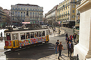 A tram passes by Largo do Camões (Camões Square) in Chiado district in Lisbon.