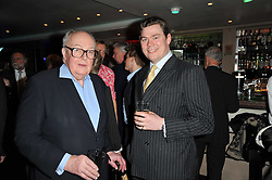 Left to right, LORD RATHCAVAN and ANGUS MACLEAN at a screening hosted by 'The Volunteer' of a documentary film of work in Haiti, held at the Courthouse Hilton Hotel, 19-21 Great Malborough Street, London on 29th March 2011.