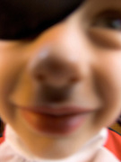 extreme close up of child with an eye patch looking in the lens of the camera