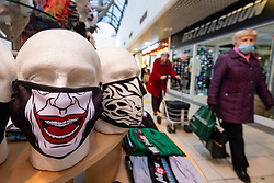 Dunfermline, Scotland, UK. 11 November 2020. Facemasks for sale in Kingsgate Shopping Centre on the High Street in Dunfermline town centre. Fife is being moved into the more severe level 3 of the coronavirus lockdown on Friday 13 November by the Scottish Government. This will mean tighter controls and opening hours of  bars and restaurants and the selling of alcohol. Iain Masterton/Alamy Live News