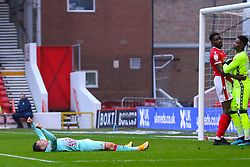 Connor Roberts of Swansea City lies prostrate, having been injured scoring his side's goal - Mandatory by-line: Nick Browning/JMP - 29/11/2020 - FOOTBALL - The City Ground - Nottingham, England - Nottingham Forest v Swansea City - Sky Bet Championship