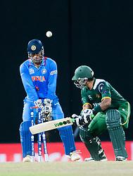 © Licensed to London News Pictures. 30/09/2012. Pakistani batsmen Mohammad Hafeez is bowled by Virat Kohli  during the T20 Cricket World super 8's match between India Vs Pakistan at the R Premadasa International Cricket Stadium, Colombo. Photo credit : Asanka Brendon Ratnayake/LNP