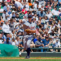 Chicago, IL - June 05, 2011:  Tigers 3rd baseman, Don Kelly (32), fields the ball against the Chicago White Sox at U.S. Cellular Field on June 5, 2011 in Chicago, IL.