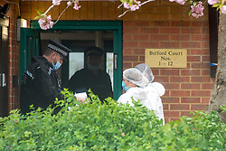 © Licensed to London News Pictures. 03/05/2021. Reading, UK. Forensic investigators at an entrance Belford Court on Luad Close following the death of a woman on Friday 30/04/2021. Thames Valley Police were called to an address on Laud Close, Reading at approximatly 16:30 BST after reports that a 34-year-old woman had died. The death was initially treated as unexplained while officers worked to establish the exact circumstances, but following a post mortem which took place on Sunday 02/05/2021 and gave the cause of death as a blunt force head injury, a murder investigation was formally launched. Photo credit: Peter Manning/LNP