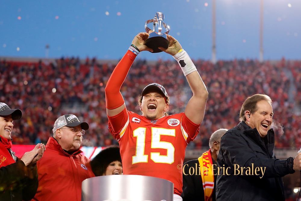 Kansas City Chiefs quarterback Patrick Mahomes holds up the Lamar Hunt Trophy during celebrations after winning the NFL, AFC Championship football game against the Tennessee Titans, Sunday, Jan. 19, 2020, in Kansas City, MO. The Chiefs won 35-24 to advance to Super Bowl 54. (AP Photo/Colin E. Braley) Colin Eric Braley Photography