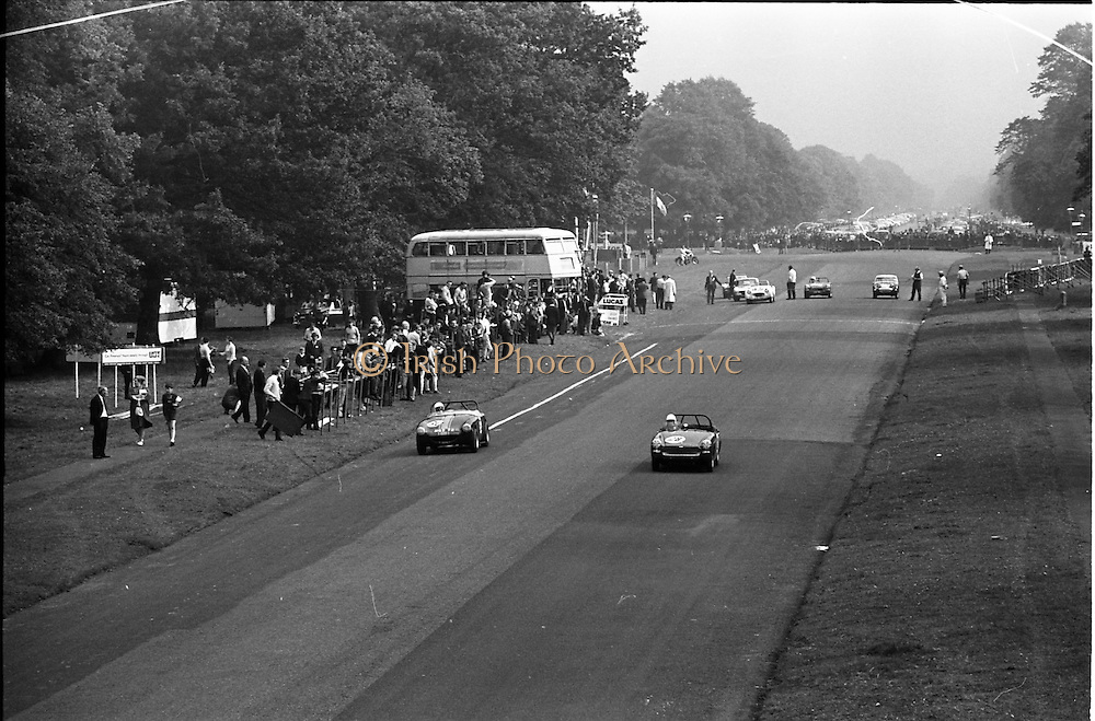 16/09/1967<br /> 09/16/1967<br /> 16 September 1967<br /> Phoenix Park Motor Racing, Kingsway Trophy Race, sponsored by Player and Wills (Ireland) Limited. <br /> Image shows D.J. Smith wick's A-H Sprite (30) and C.J. Hololhan's M.G. Midget.