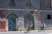 Cyclists ride Bianchi roadbikes on The Stelvio Pass, Passo dello Stelvio, Stilfser Joch, in Northern Italy
